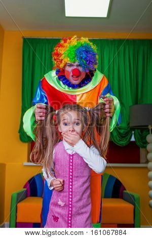 Little girl was frightened of the clown.