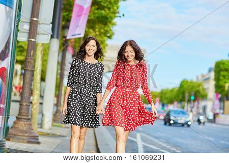 Beautiful Twin Sisters In Front Of Arc De Triomphe