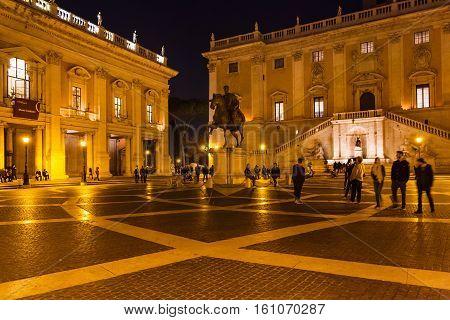 Tourists On Piazza Del Campidoglio In Night
