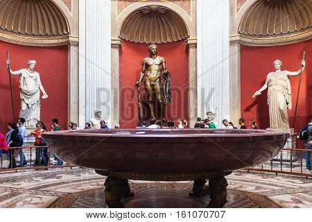 Hercules Sculpture And Porphyry Basin In Vatican