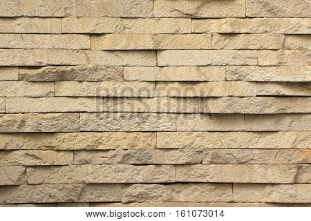 a background of large yellow porous brick