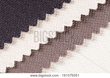 Background composition of colored diagonal stripes of serrated cotton fabric.place for text