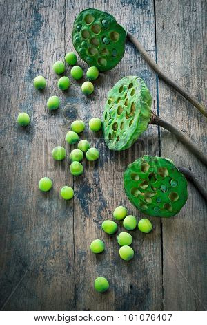 Lotus seeds and calyx on wooden background