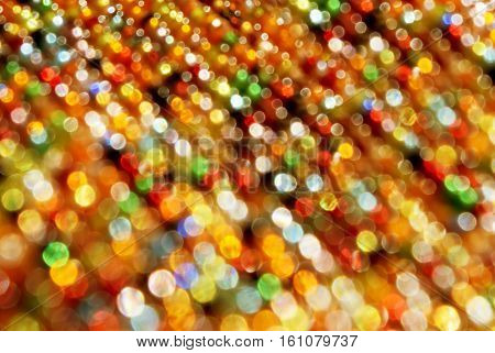 Blured red yellow and green christmas light background