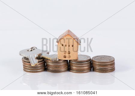 House and the stack of coin investment and real-estate concept