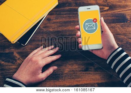 SMS receive notification on smartphone screen female hands using mobile phone