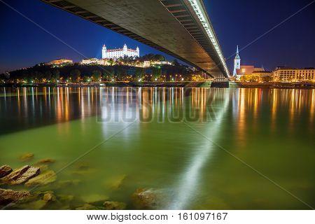 Bratislava, Slovakia. Cityscape image of Bratislava riverside at night.