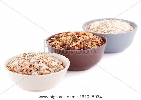 Musli in the bowl isolated on white background.