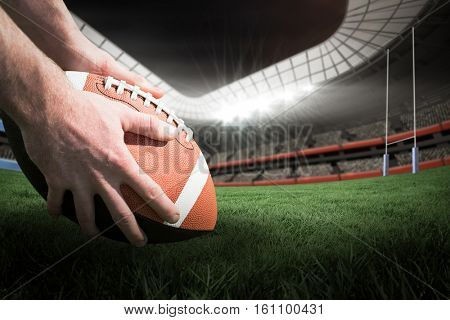 Close up view of american football player preparing for a drop kick against rugby pitch 3D