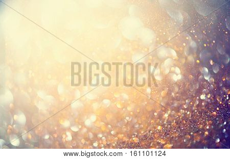 Christmas gold background. Golden holiday glowing backdrop. Defocused Background With Blinking Stars. Blurred Bokeh