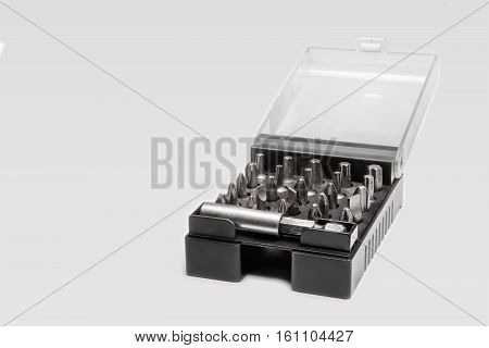 Set of screw tips in a black plastic box on white background