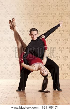 Dance beautiful couple dancing ballroom dancing on wall background