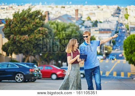 Romantic Couple Of Tourists Using Tablet In San Francisco, California, Usa