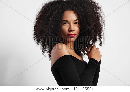 black woman with big afro hair and bright lips