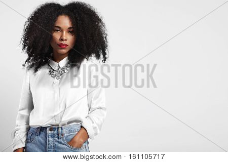 Black Woman Wears Jeans And White Silk Shirt. Afro Hair