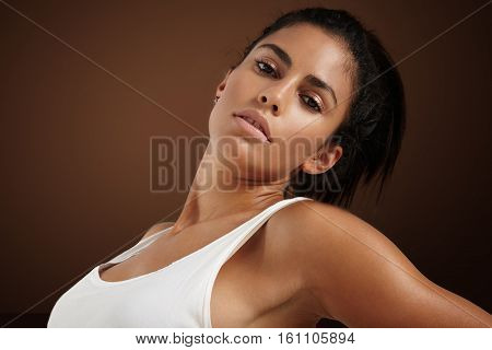 beauty spanish woman with ideal strobing skin poster