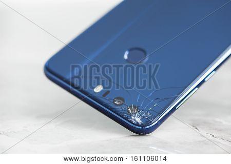 Broken mobile phone back camera into pieces