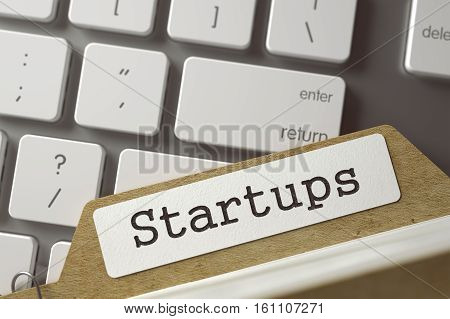 Startups Concept. Word on Folder Register of Card Index. Archive Bookmarks of Card Index Lays on Modern Metallic Keyboard. Closeup View. Selective Focus. Toned Image. 3D Rendering.