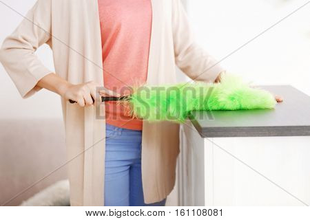Close up view of woman cleaning house from dust