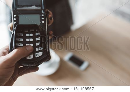 Consument Entering Pin Code On Card Terminal