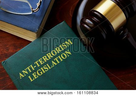 Anti-terrorism legislation title on a book and gavel.