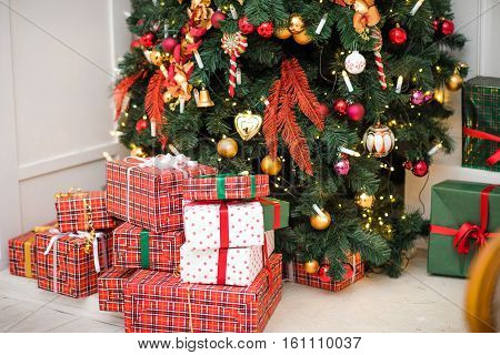 Gifts under the Christmas tree lights background