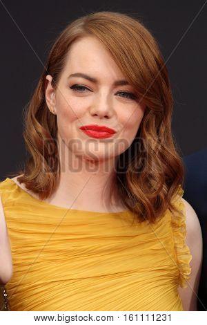 LOS ANGELES - DEC 7:  Emma Stone at the Emma Stone & Ryan Gosling Hand and Foot Print Ceremony at TCL Chinese Theater on December 7, 2016 in Los Angeles, CA