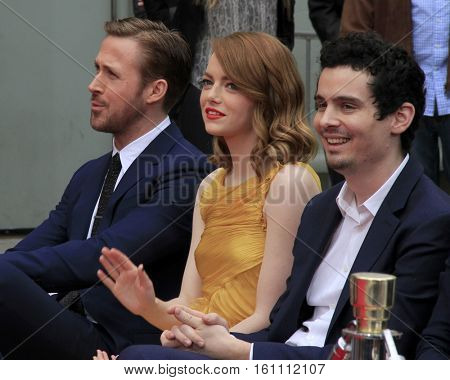 LOS ANGELES - DEC 7:  Ryan Gostling, Emma Stone, Damien Chazelle at the Emma Stone & Ryan Gosling Hand and Foot Print Ceremony at TCL Chinese Theater on December 7, 2016 in Los Angeles, CA