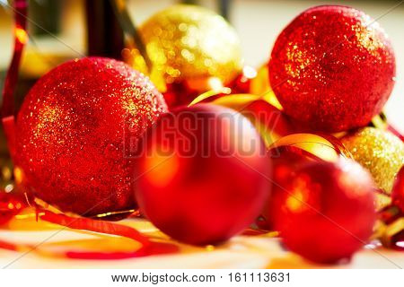Red and gold Christmas balls on decorative background