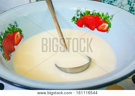 Kumis or kimis fermented horse milk in old fashioned style bowl. Drink typical of central Asia