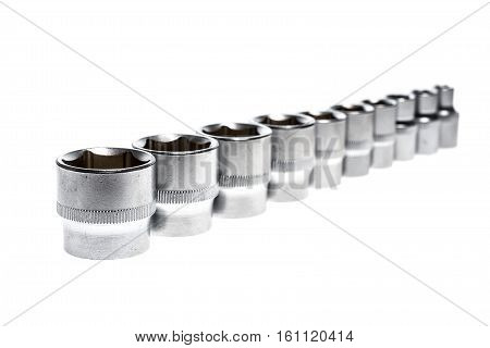 Set Of Metallic Socket Wrench Tools Isolated On White Background.