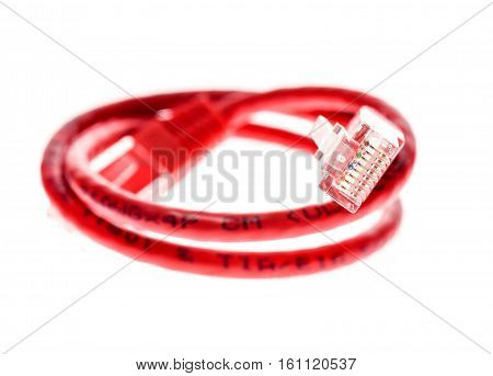 Red Network Utp Cable With Rj45 Connector Isolated On White.