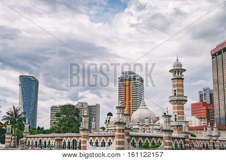Kuala Lumpur, Malaysia - February 7, 2016: Cityscape with modern and old traditional building and Masjid Jamek Mosque in Kuala Lumpur, Malaysia.