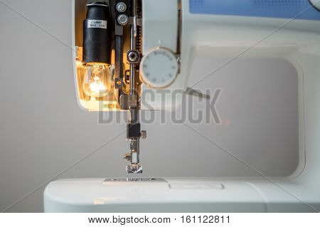 Sewing machine on empty background