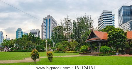 Panorama view of Bangkok skyline from Lumphini Park, Thailand. Lumphini Park is a popular place for walks and sport activities.