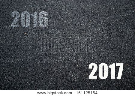 Good bye Old year 2016 and Happy New year 2017 on Asphalt Texture Background