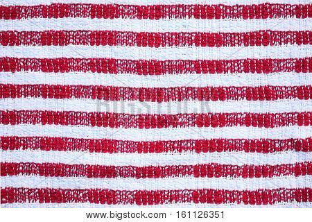 Background of red and white striped dish cloth tea towel
