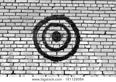 Black And White Target On Brick Wall.