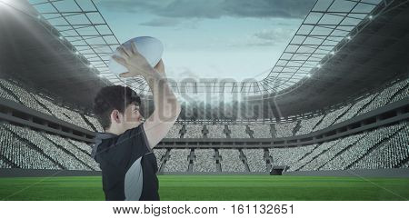 3D Profile view of rugby player throwing a ball against rugby stadium