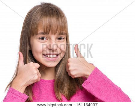 Close-up emotional portrait of attractive caucasian girl. Beautiful happy schoolgirl making thumbs up gesture and looking at camera. Funny cute smiling child, isolated on white background.