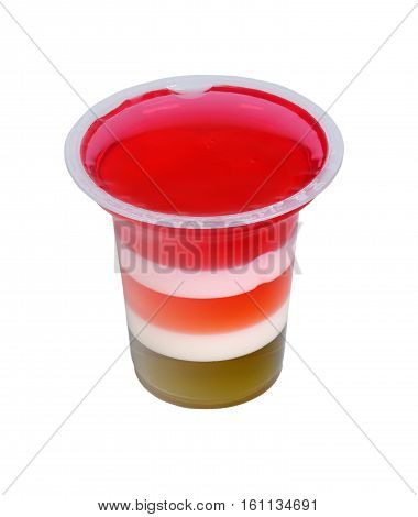 Plastic glass with striped jello. Isolation on a white background