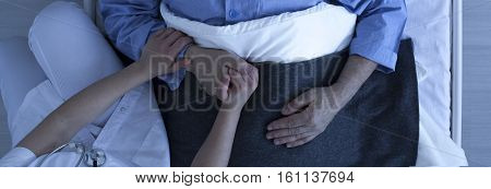 Nurse Holding Older Man's Hand