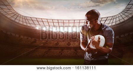 3D Rugby player looking away while catching ball against rugby stadium