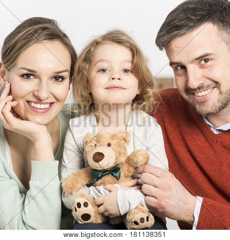 Smiling Parents With Their Kid