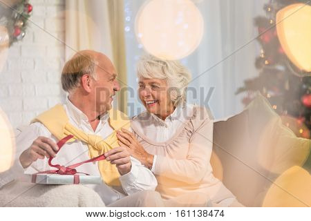 Senior Man Unwrapping Christmas Present