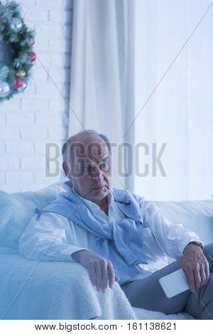 Lonely Senior Man At Christmas