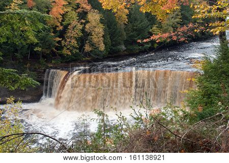 A very picturesque Upper Fall on the Tahquamenon River in framed autumn trees, Tahquamenon Falls State Park Chippewa County Michigan USA