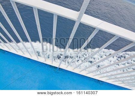 Closeup White Railing Foamy Mediterranean Water