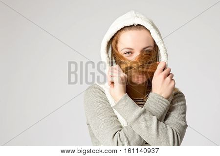 Portrait Of A Laughing Girl, Hiding Her Face By Hair. Pretty Young Woman With Long Hair Covered Her