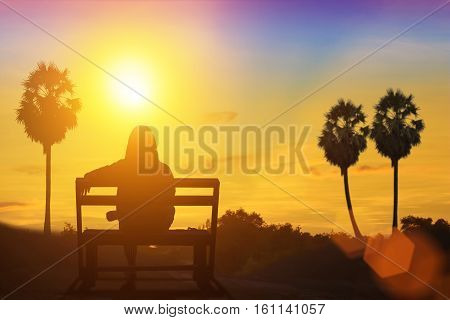 Silhouette of The waiting under the sun. Natural background blurring.warm colors and bright sun light.adult alone angry betrothal break-up couple dark dead death destiny divorce feelings life trip.